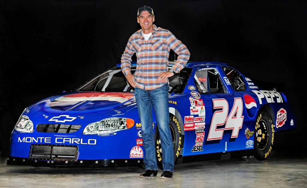 MOORESVILLE, NC - OCTOBER 28, 2014: Ray Evernham with Jeff Gordon's 1999 No. 24 Pepsi Chevrolet Monte Carlo at Ray Evernham Enterprises in Mooresville, NC (2014 pixelcrisp)